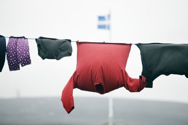 Clothesline with flag of the Shetland Islands group outdoors on a windy day. Fair Isle, Shetland Islands, Scotland