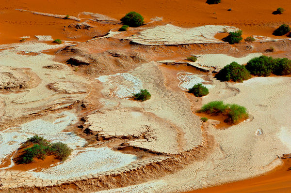 Desert claypan and sand dunes, from the air, Sossusvlei, Namib-Naukluft National Park, Namibia