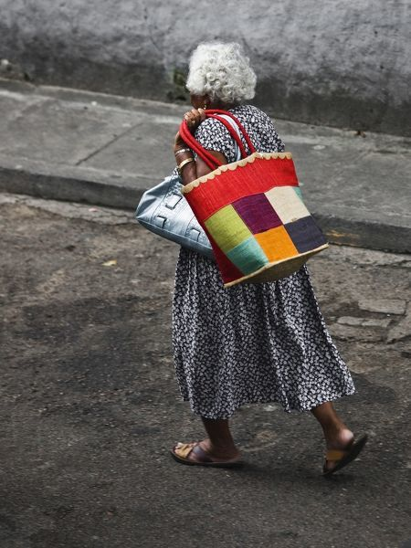 Elderly Seychellois woman with shopping bag, Victoria, Mahe Island, Seychelles