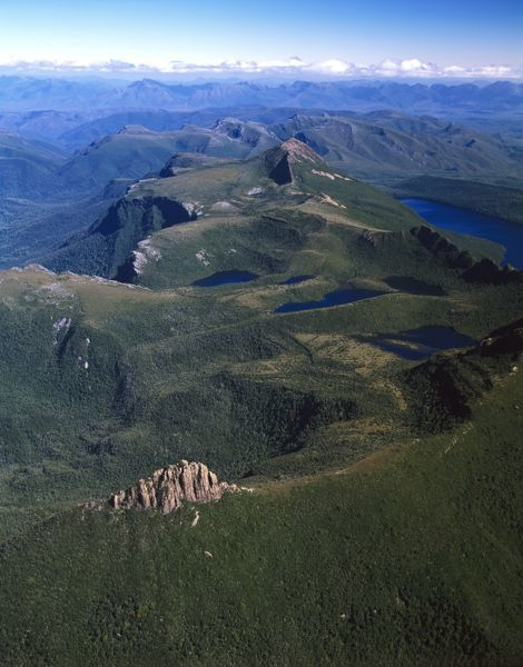 The Lot (bottom centre), Lonely Tarns, Lake Judd and Mount Sarah Jane (pyramidal, middle distance), with Arthur Range beyond. Aerial photograph. Southwest National Park, Tasmania, Australia