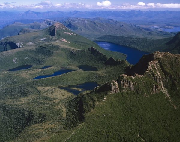 The Lot (bottom right), Lonely Tarns, Lake Judd and Mount Sarah Jane (pyramidal, middle distance), with Arthur Range beyond. Aerial photograph. Southwest National Park, Tasmania, Australia