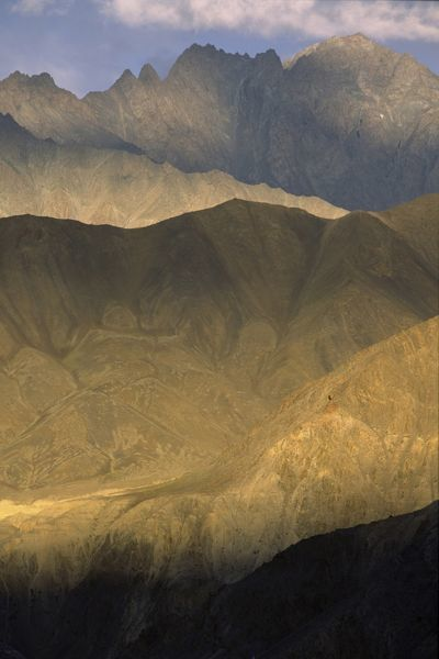 Mountains bathed in late afternoon sunlight near Lamayuru Monastery. Ladakh region, Jammu and Kashmir, India