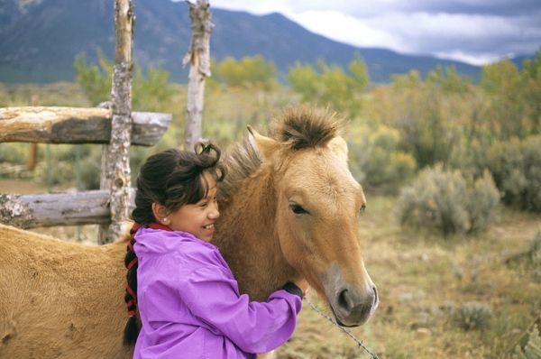 Native American child with pony, Taos Pueblo, Taos, New Mexico, USA