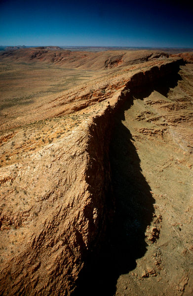 Petermann Range, a 320 km-long cliff remnant of a massive chain of folds that erupted across central Australia when a large North China block crushed Australia against Antarctica