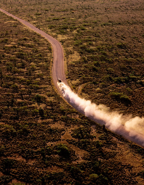 Road train carrying iron ore, from the air. Pilbara region, Western Australia