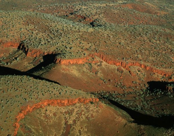 South-western side of the Hamersley Range, aerial photograph. The Pilbara seabed rose to form one of the Earth?s first permanent land masses about 3.5 billion years ago. The area shown is rich in iron oxides. Hamersley Range, Pilbara region