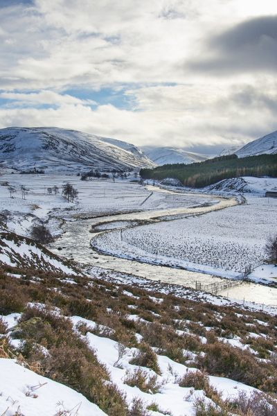 Valley of the River Dee under snow looking west to the summit of Creag Bhaig and the Cairngorms. near Braemar, Aberdeenshire, Highlands, Scotland