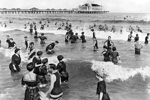 1911: bathers in the waters of the Atlantic with the Steel Pier