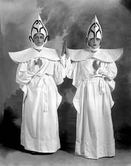 1920: two young women dressed in matching costumes