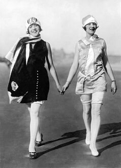 1920s: two women modelling fashionable beach wear