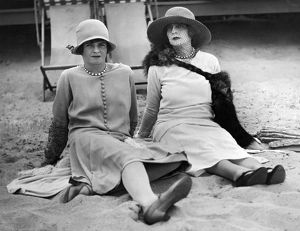 1926: New York society matron and her daughter relaxing on beach