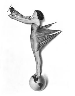 1927 pinup girl standing on globe