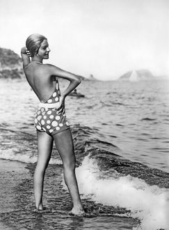 1929: Alice Nikitina posing at beach in stylish bathing suit
