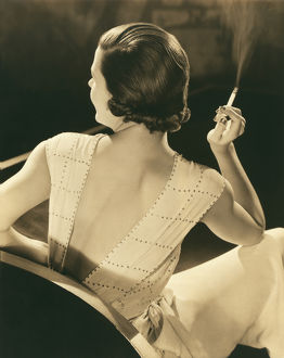 1932: young woman seated with cigarette in her hand