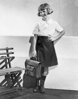 1933: school girl wearing home made school clothes