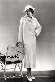 1936: fashion model posing in white summer suit