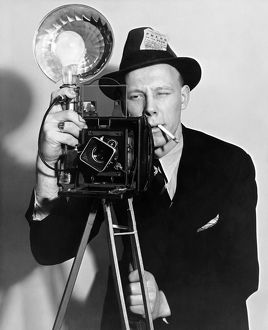 1938: portrait of a press photographer