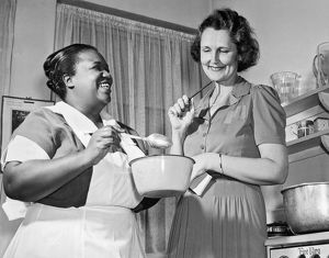 1939: Mrs Paul McNutt and her cook in kitchen