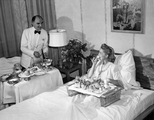 1943: guest at the Pierre Hotel enjoying breakfast in bed