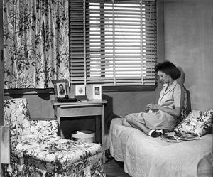 1944: woman in her room at Arlington Farms