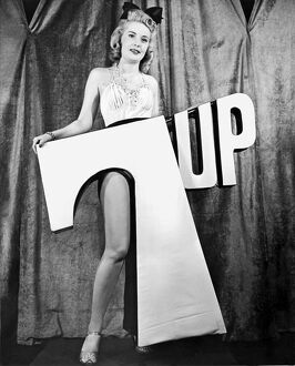 1945: model holding 7 UP logo