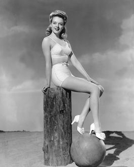 1946: young woman modelling two piece bathing costume