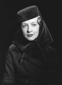 1948: fashion portrait of model wearing a hat
