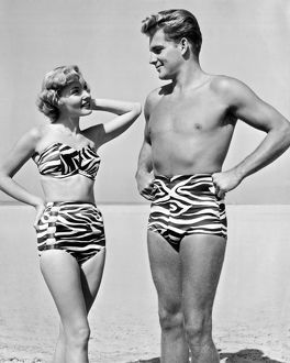 1950: young man and woman modelling zebra print bathing suits