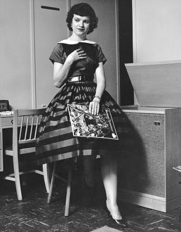 1952: young woman listening to the gramophone