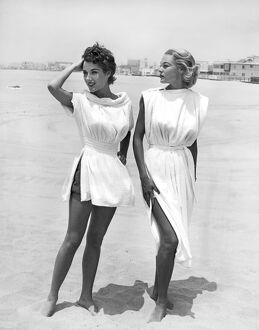 1954 fashion photograph of two female models wearing terry cloth