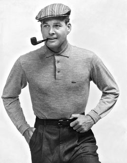 1954: male fashion model wearing sportive outfit and smoking a p