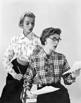 1961: fashion photograph of two models wearing business styles