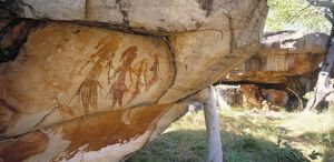Aboriginal cave paintings: Gwion Gwion figures of males with headdresses, tassels and arm-bands,
