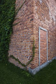 Bricked up doorway in brick wall,