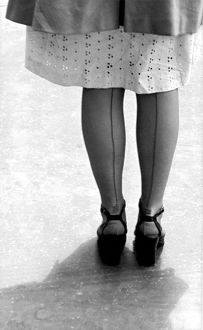 ca 1950: photograph of woman wearing stockings with seams at the