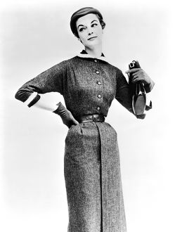 ca 1955: fashion photograph of woman modelling a pencil dress, g