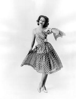 ca 1960: fasion photograph of woman modelling polka dot dress by