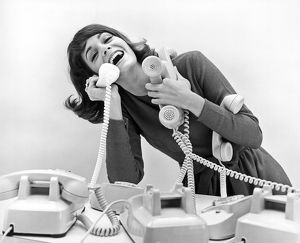 ca 1968: a busy young woman answers many telephones