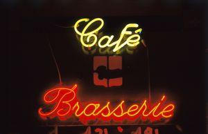 Cafe and brasserie neon signs at Les Halles at night,