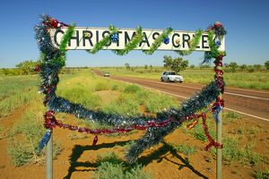 Christmas Creek sign appropriately decorated for December 25,