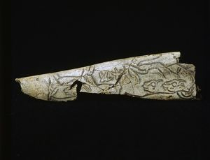 Engraved bone depicting birds and ibexes,