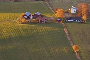 Farmhouse and outbuildings in autumn,