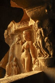 Figure of Ganga the river goddess carved in the rock in Rameshvara, one of the Hindu caves