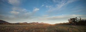 The Flinders Ranges with a moon in the sunrise sky.