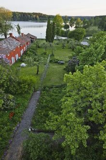High angle view, of house and garden on the edge of a lake,