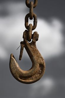 Hook on the end of an iron chain,