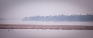 Low-lying mist at sunrise over the Mekong River,