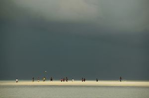Maldives islanders playing football on a sand spit