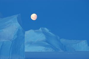 Full moon over icebergs,