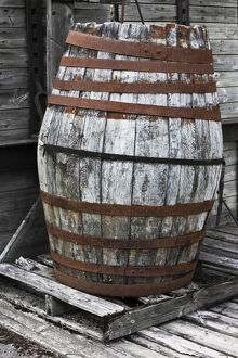 Old wooden barrel with rusty hoops,